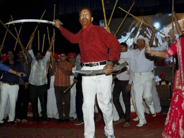 Retired IPS officer D G Vanzara dances with a sword during a welcome ceremony by his community in Gandhinagar on Friday, April 8, 2016.
