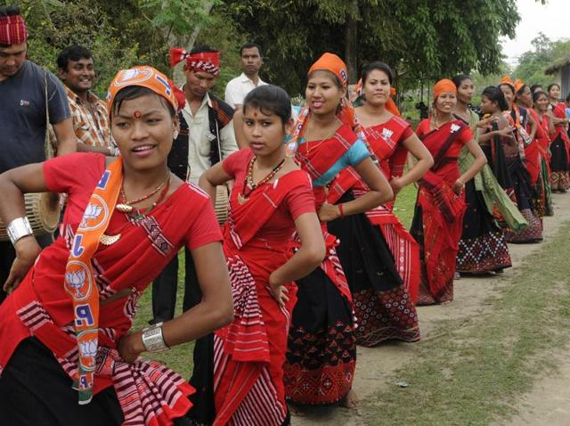 BJP candidate Sarbananda Sonowal (not in picture) was being welcomed by traditional dancers during his election campaign at Mishing village, Majuli of Assam on April 1.