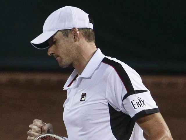 Former champion and top seed John Isner booked a Houston Open  semifinal clash against countryman and defending champ Jack Sock.