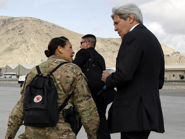 US Secretary of State John Kerry, right, arrives at Kabul International Airport for a day of meetings with Afghan leaders in Kabul.