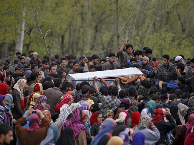 Kashmiris carry the body of Waseem Ahmad Malla, a suspected militant, after his funeral prayers in Pehlipora village in Shopian district..