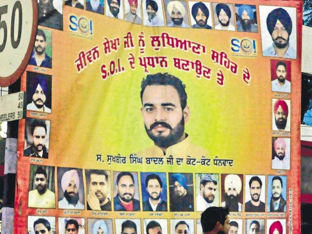 Hoarding of Gaurav Sharma, along with SOI members and SAD leaders, in Ludhiana on Friday.