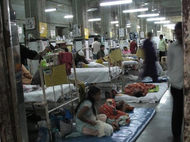Patients lie on mattresses on the floor, at Mumbai's perennially overcrowded KEM civic hospital. Investment in public health infrastructure must start now, in order to have it in place by 2030, says Dr Henk Bekedam.