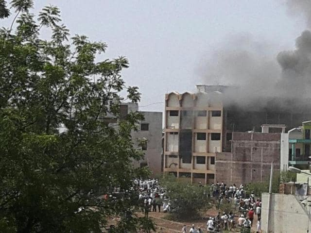 A mob had set police vehicles and the office of a minority-run school on fire, in Malegaon on Friday.