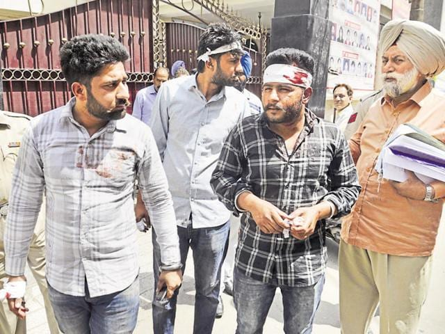 Policemen with some of the injured youths outside DAV College at Hathi Gate in Amritsar on Saturday.