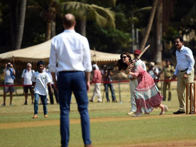The Duke and Duchess of Cambridge play cricket at the Oval Maidan with cricket legend Dilip Vengsarkar.