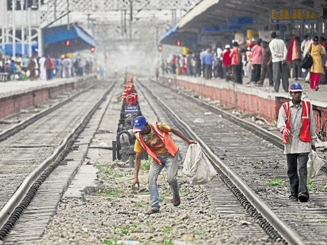 Railway employees collecting garbage from the tracks in Jalandhar on Saturday.