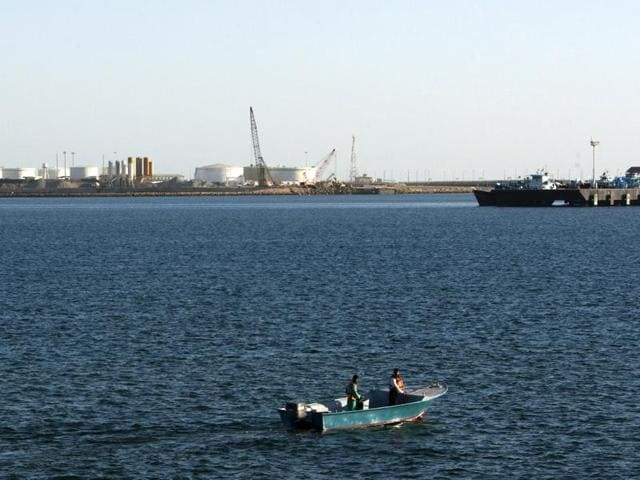 A speed boat passes by oil docks at the port of Kalantari in the city of Chabahar, east of the Strait of Hormuz in this January 17, 2012 file photo.