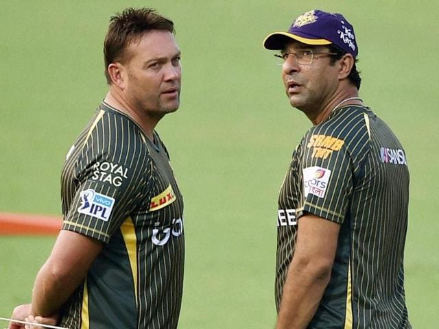 KKR coach Jacques Kallis and bowling coach Wasim Akram busy during team's training session.