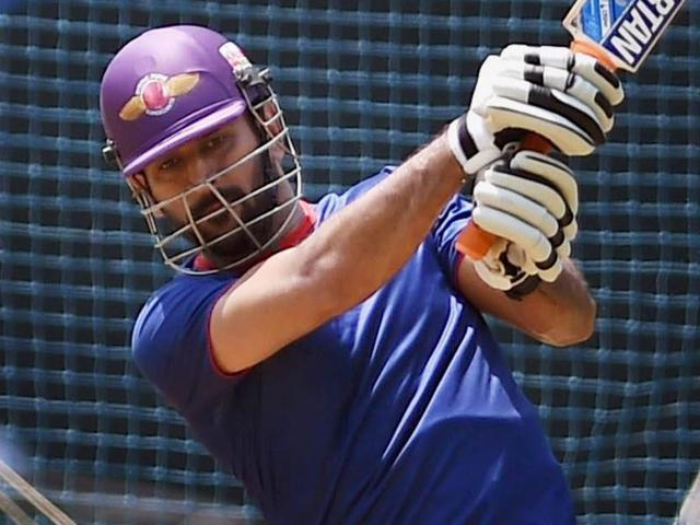 Rising Pune Supergiants' captain M S Dhoni bats in the nets during the practice session in Mumbai.