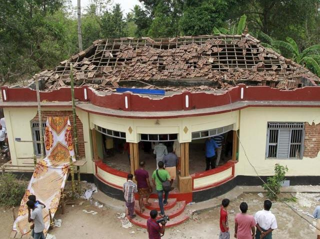 People gathered in the temple premises after the fire mishap took place early on Sunday.