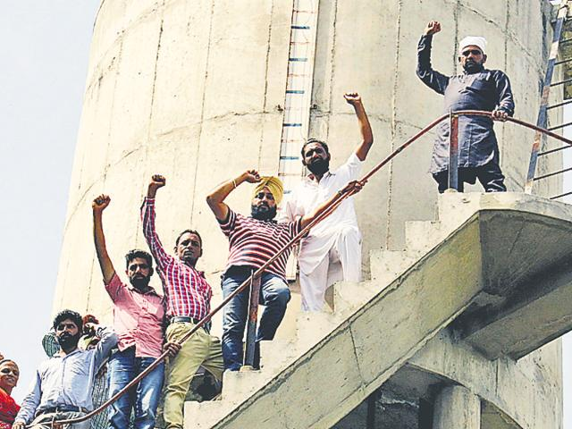 Protesting teachers atop a water tank at Talwandi Sabo on Sunday.