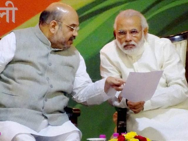 BJP chief Amit Shah interacts with Prime Minister Narendra Modi during party's national executive meet in New Delhi.