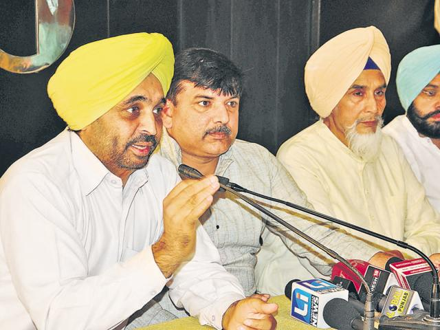 (From left) Aam Aadmi Party leaders Bhagwant Maan, Sanjay Singh, and Sucha Singh Chhotepur during a press conference in Chandigarh on Sunday.
