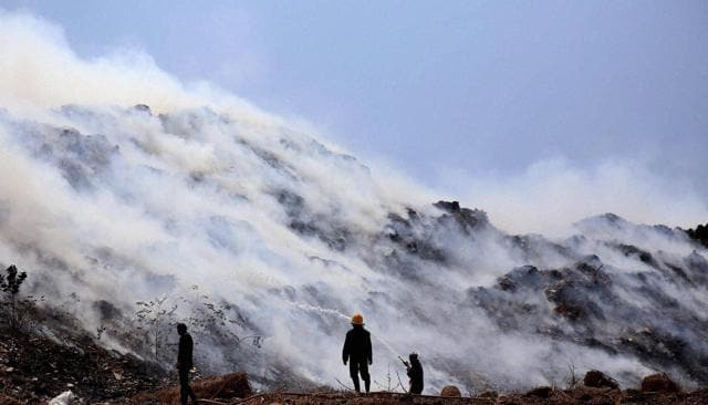 Smoke billowing out after a fire broke out at the dumping yard at Mulund in Mumbai on Monday.
