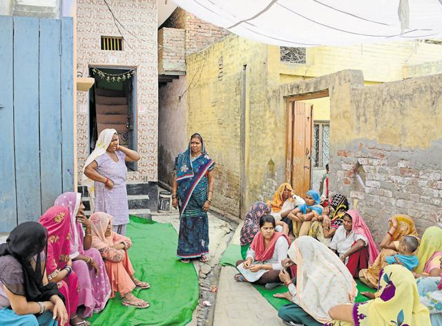 Dalit community members gather in the village on Sunday.