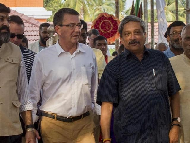 US defence secretary Ash Carterwalks with Indian defence minister Manohar Parrikar as they tour the Mangeshi Temple in Old Goa on Sunday.