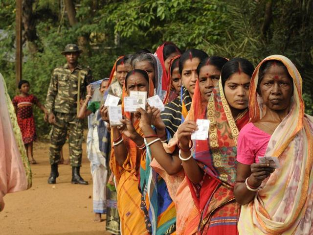 File photo of people standing in queue to cast their vote at Magura Primary School in Jangalmahal area in West Bengal  on April 04, 2016.