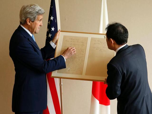 G7 foreign ministers , US secretary of state John Kerry and (4th from left), Japan's foreign minister Fumio Kishida stand together after placing wreaths at the cenotaph at Hiroshima Peace Memorial Park and Museum in Hiroshima.