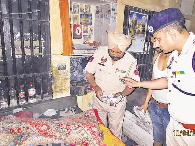 Cops carrying out a search operation at the Modern Jail in Kapurthala on Sunday.
