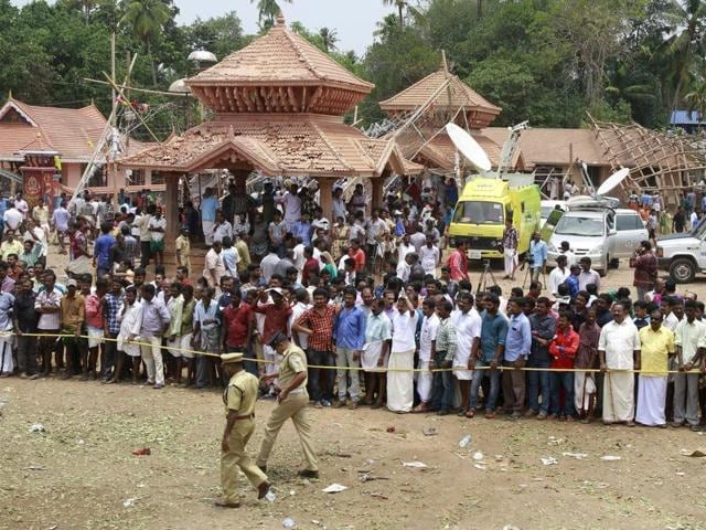 Policemen cordon off the area after a fire broke out at a temple in Kollam in Kerala. A fire swept through a temple in Kerala  early on Sunday.