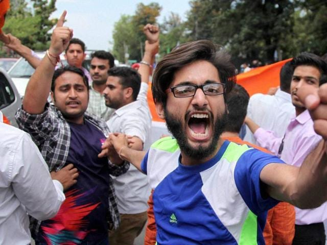 Activists of the ABVP protest over the NIT Kashmir controversy in Jammu on Monday.
