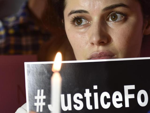 Family members and friends of Siddharth Sharma protest at Central Park in New Delhi.