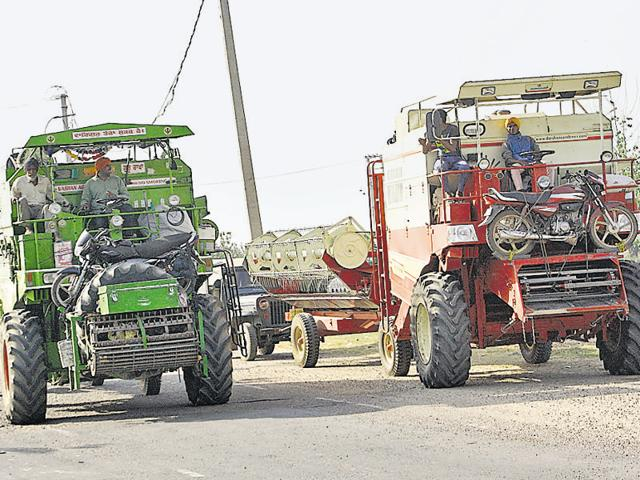 Hundreds of combine harvesters from Punjab have descended on Haryana, causing losses to local operators, but benefitting farmers with lesser harvesting cost.