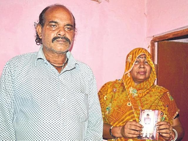 Narendra Singh Chauhan and wife Neera Devi, parents of attacked medical student Indrajeet Singh Chauhan.