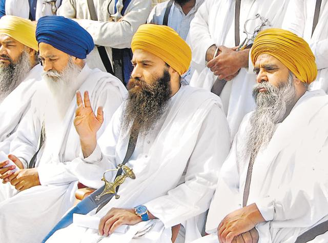 Preacher Baljit Singh Daduwal (second from right) interacting with mediapersons in Bathinda on Monday.