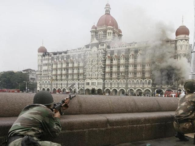 Mumbai under attack - fire and smoke seen emerging from the Taj Hotel , one of the targets of Lashkar-e-Taiba terrorists during the assault on India's financial hub in November 2008.