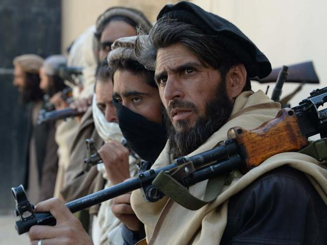 This Feb 24 file photo shows former Afghan Taliban fighters carrying their weapons before handing them over as part of a government peace and reconciliation process at a ceremony in Jalalabad. The Taliban has dubbed their Spring offensive as