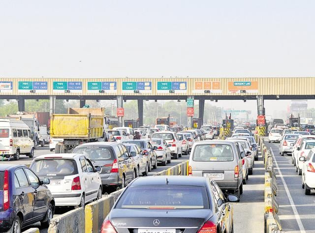 Vehicles crawl in front of a toll plaza near Gurgaon on NH8.