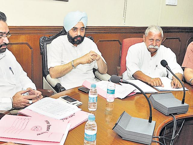 Mayor Amarinder Singh Bajaj addressing the finance and contract committee meeting at the MC Office in Patiala on Monday.
