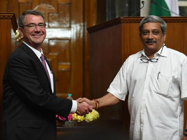 US defence secretary Ashton Carter shakes hands with defence minister Manohar Parrikar after a press conference in New Delhi.