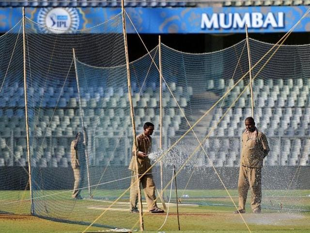 Groundsmen water the pitch at the Wankhede stadium ahead of IPL matches in Mumbai on Wednesday, April 6, 2016, ahead of the start of season 9 of IPL.