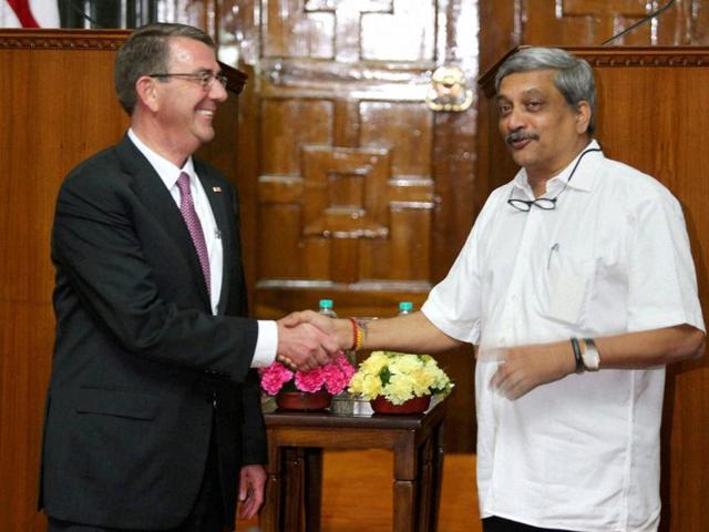 Union defence minister Manohar Parrikar shakes hands with his US counterpart Ashton Carter in New Delhi on Tuesday.