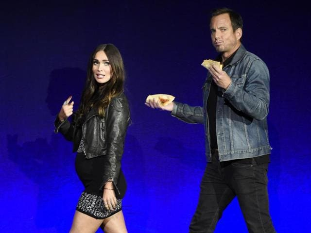 Megan Fox and Will Arnett, cast members in the upcoming film Teenage Mutant Ninja Turtles: Out of the Shadows, take the stage during the Paramount Pictures presentation at CinemaCon 2016.