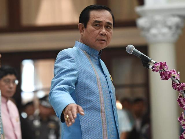 Thai Prime Minister Prayuth Chan-ocha addresses officials during the Songkran - or Thai new year - merit-making ceremony at Government House in Bangkok on Tuesday.