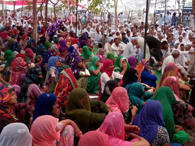 Members of the Jat community gathered under the banner of All India Jat Aarakshan Sangharsh Samiti, near the deputy commissioner's officer in Fatehabad on Wednesday.