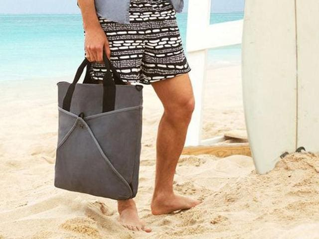 A beach tote can carry all your summer essentials: sunblock, deodorant and an iPod.