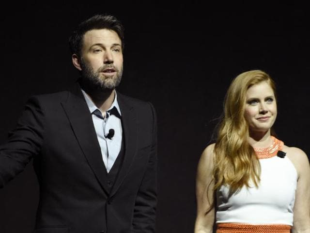 Ben Affleck, left, and Amy Adams, cast members in the film Batman v Superman: Dawn of Justice, address the audience during the Warner Bros. presentation at CinemaCon 2016.