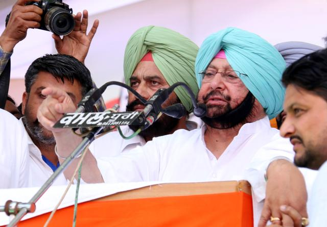 Punjab Pradesh Congress Committee president Captain Amarinder Singh addressing a gathering during conference on Baisakhi in Talwandi Sabo on Wednesday.