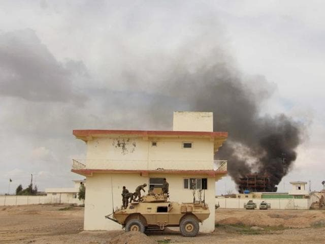 Smoke billows from a building after a Taliban attack in Helmand province of Afghanistan on March 9.