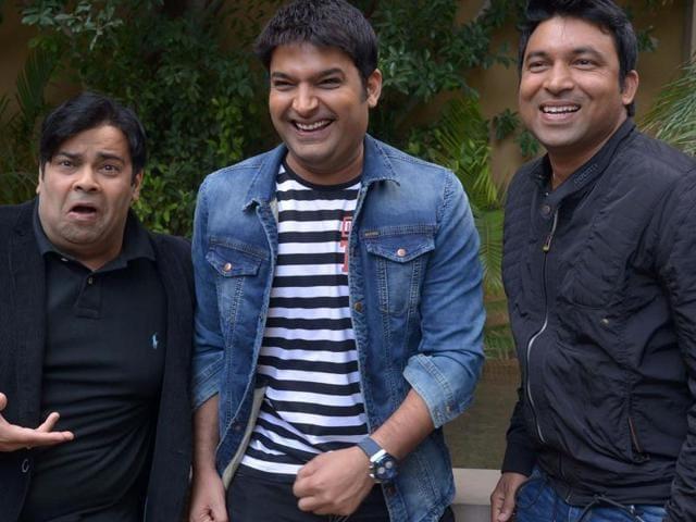 Stand-up comedians and TV actors Kapil Sharma, Chandan Prabhakar (R) and Kiku Sharda (L)share a light moment during a promotional event for the forthcoming comedy show, The Kapil Sharma Show.