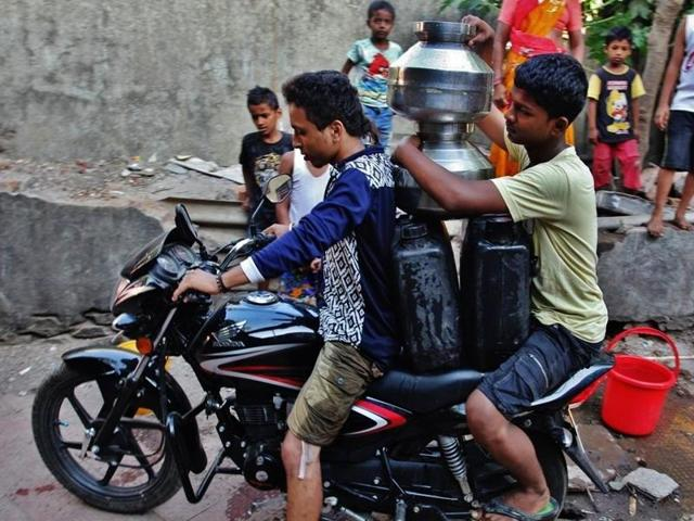 Water cuts across city have forced people to stock up.