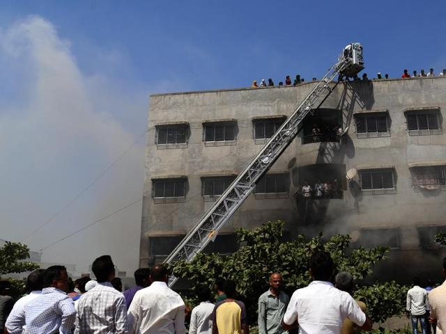 Rescue operations in progress at Rahat Manzil in Bhiwandi on Tuesday morning.