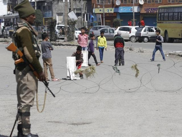 A paramilitary soldier stands guard during the curfew restrictions in downtown Srinagar.
