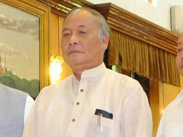 Manipur governor V Shanmuganathan and chief minister Okram Ibobi Singh with the newly sworn ministers during the swearing-in-ceremony at Raj Bhawan Imphal, Manipur, on Tuesday.