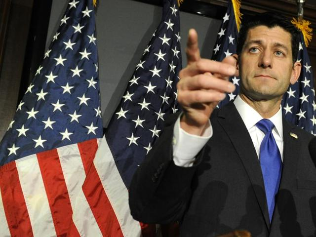 US House Speaker Paul Ryan gestures during a news conference at the Republican National Committee headquarters in Washington, DC.